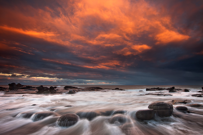 evening light, a fiery sunset along the great ocean road, melbourne, victoria