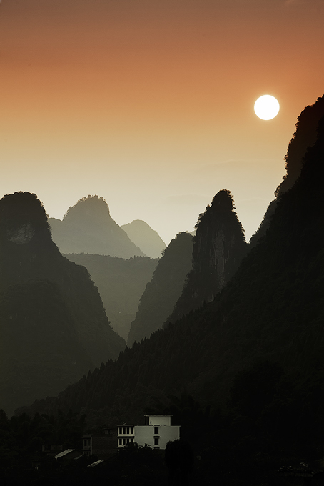 Karst mountains with building, Guilin, China