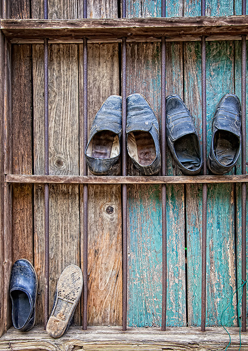 Shoes arranged in an old window frame, Guilin, China.