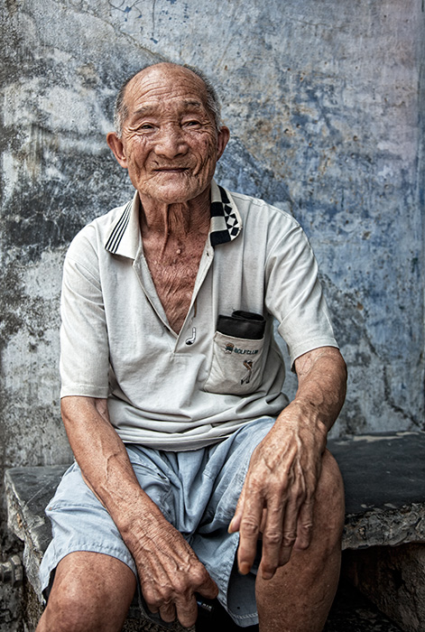 Portrait of man in Old Xing Ping Town, Guilin, China.