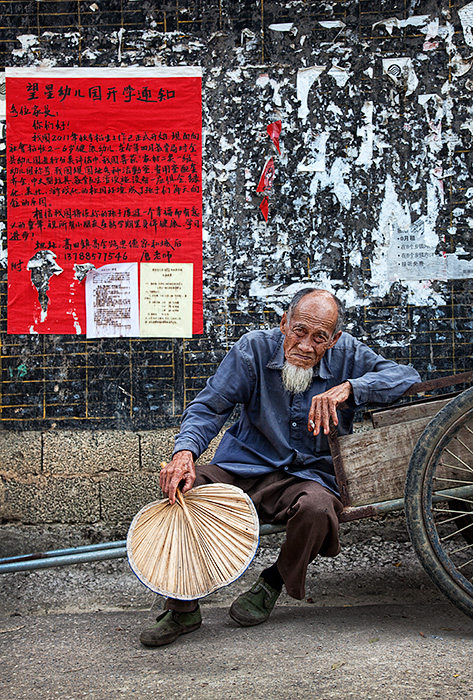 Village elder taking time out, Yangshuo, China.