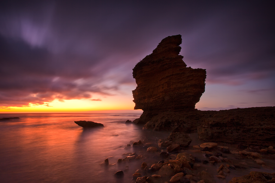 Setting sun and rock formations at Anglesea, Victoria. Photo © Darren J Bennett. All Rights Reserved.