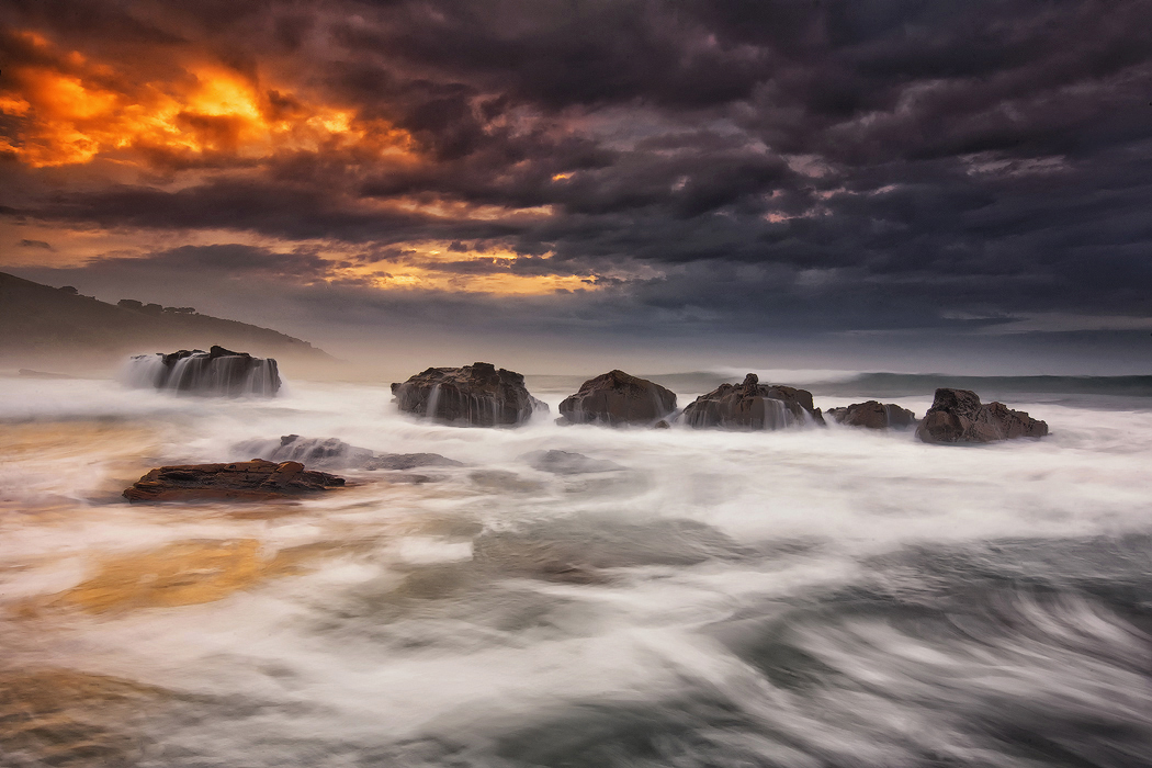 Dramatic clouds and movement of water in Apollo Bay, Victoria. Photo © Darren J Bennett. All Rights Reserved.