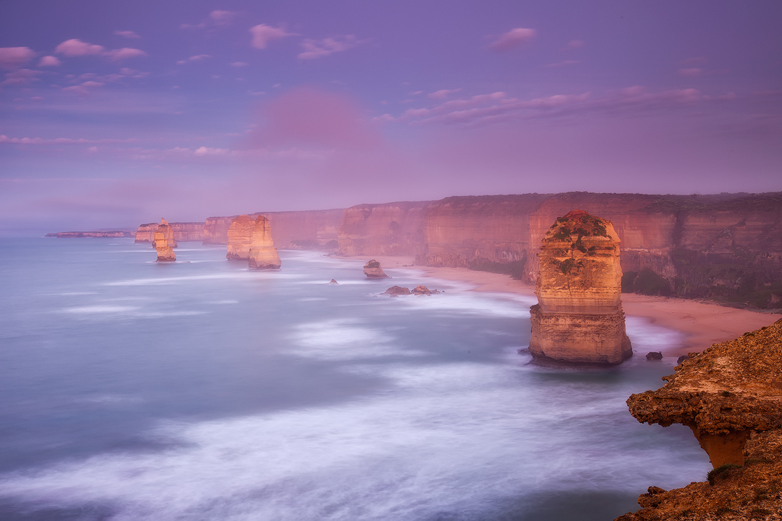 Subtle pink and purple hues in the early morning at the 12 Apostles, Port Campbell, Victoria. Photo © Darren J Bennett. All...