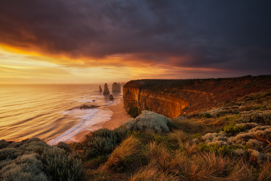 A stunning sunset lights up the landscape at the 12 Apostles, Victoria. Photo © Darren J Bennett. All Rights Reserved.