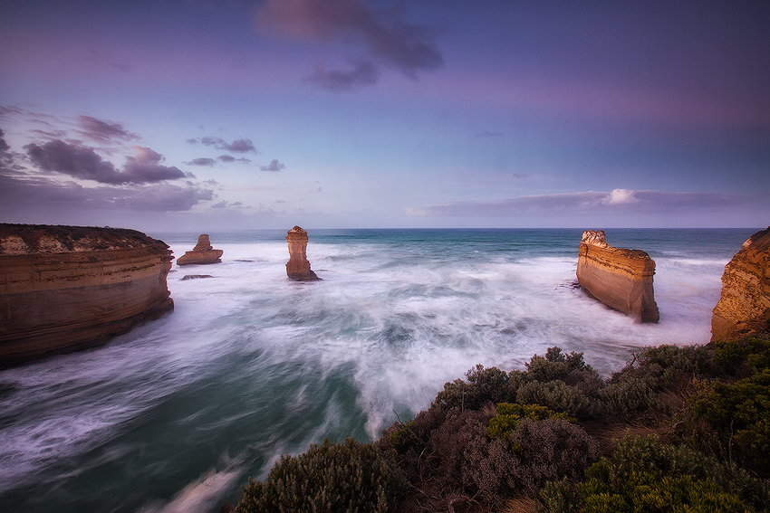 Long exposure creates a milky water surface with lots of movement, Great Ocean Road, Victoria. Photo © Darren J Bennett. All...
